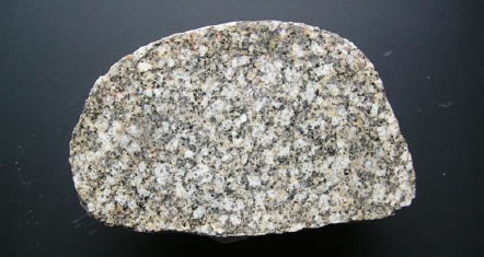 Granite from the southern uplands of S W Scotland. This granite is about 425-410 Ma old and has travelled about 100 miles to get to Brockholes.