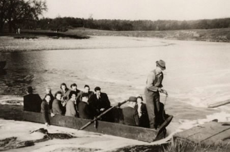 A boat carrying passengers across the river Ribble at Dinckley