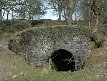 The well-preserved base of a field kiln near Cow Ark, probably of an early 19th century date. Like many such kilns, it was built into a slope so that the limestone could be transported downhill en route to the kiln.